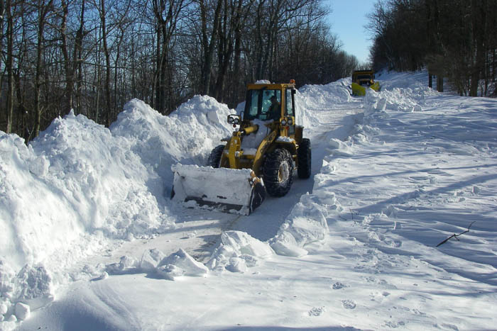 Equipment clearing snow on a roadway